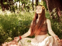 19856560-hippie-yoga-girl-in-meditation-in-the-forest