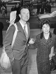 Seeger, a banjo slung over his shoulder, with his wife Toshi, arrives at th