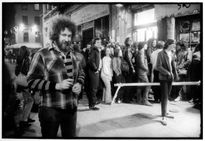 2. The club's owner, Hilly Kristal, stands outside among the crowd waiting to get in (1977).